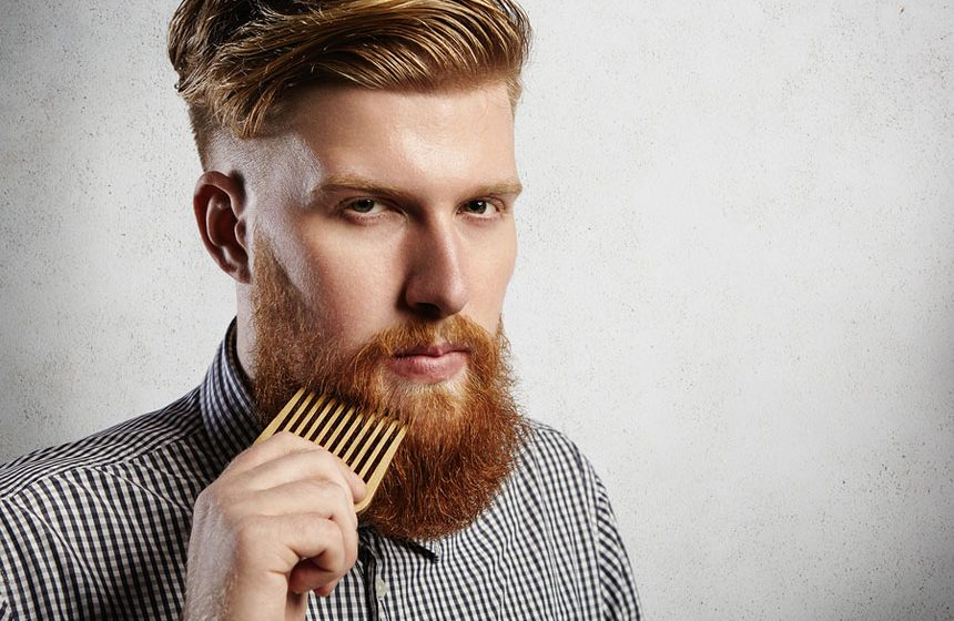 Portrait Of Young Attractive Redhead Hipster Male With Serious A